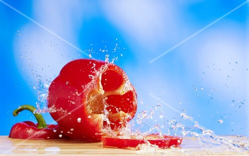 A red pepper with a splash of water