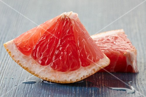 Two wedges of pink grapefruit