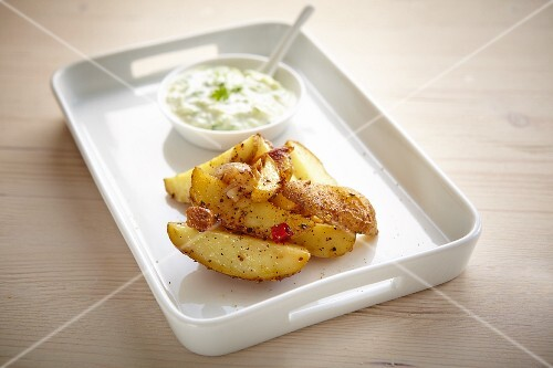 Potato wedges with sour cream