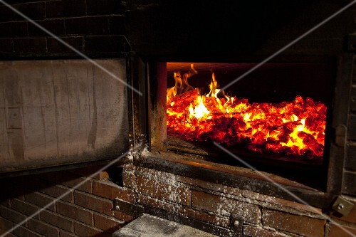 A fire in a wood-fired oven