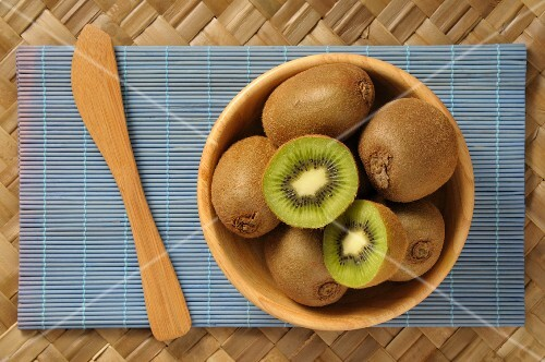 Kiwis in a wooden bowl