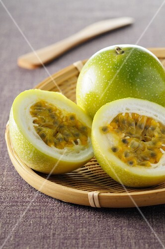 Passion fruit, whole and halved
