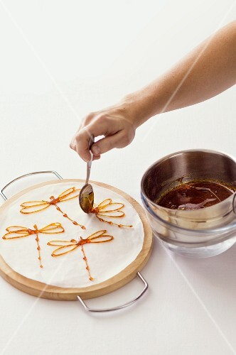 Dragonflies being made from caramel