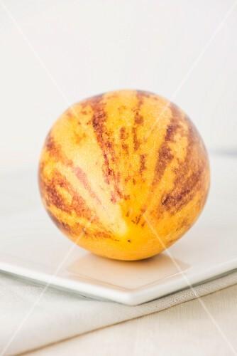 A Pepino melon on a plate
