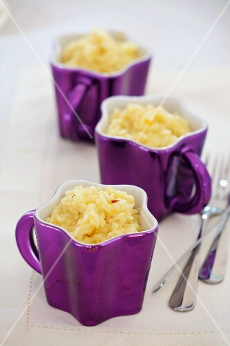Three cups of lemon risotto with saffron
