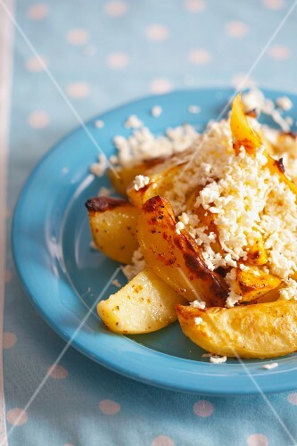 Oven-baked potatoes with herbs and grated feta