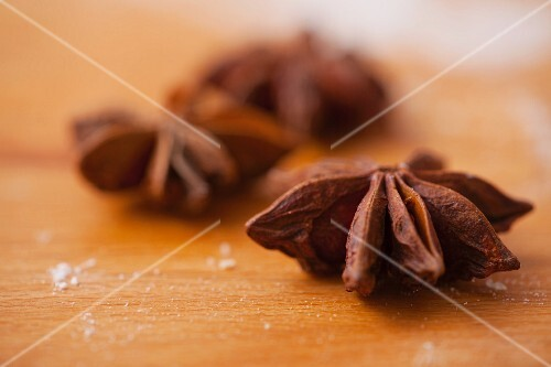 Star anise on a wooden board (close-up)