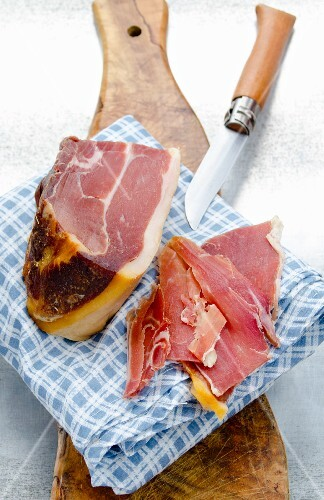Spanish Serrano ham, a large piece and slices