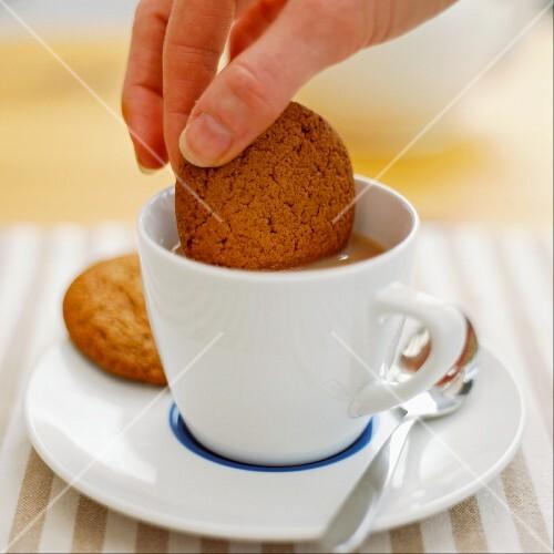 Biscuit dunking in tea