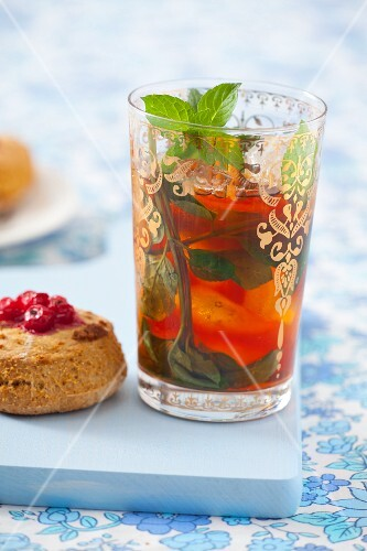 Iced tea with ice cubes and mint