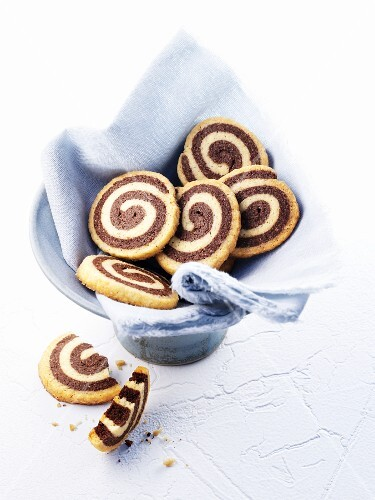Black and white biscuits on a cloth