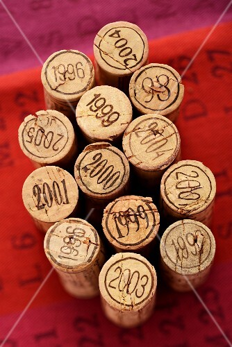 Assorted wine corks marked with the year