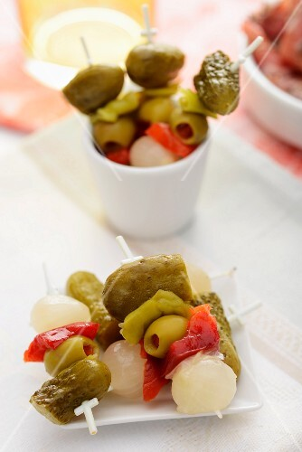 Cocktail skewers with olives, pickled gherkins and pearl onions