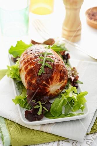 Rolled roast turkey with salad