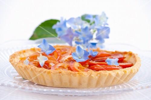 Orange tart with blue hydrangea flowers