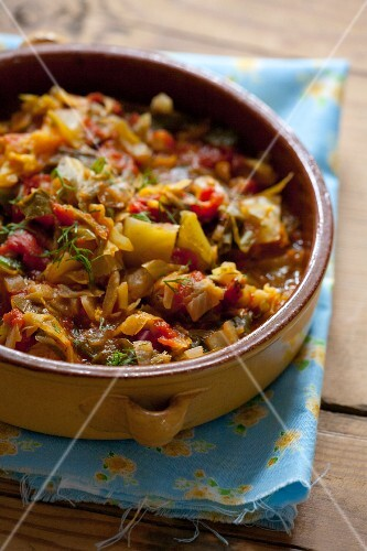 Bigos (sauerkraut casserole with meat, onions, tomatoes, Poland)