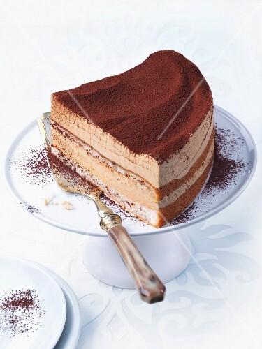 Tiramisu layer cake on a cake stand
