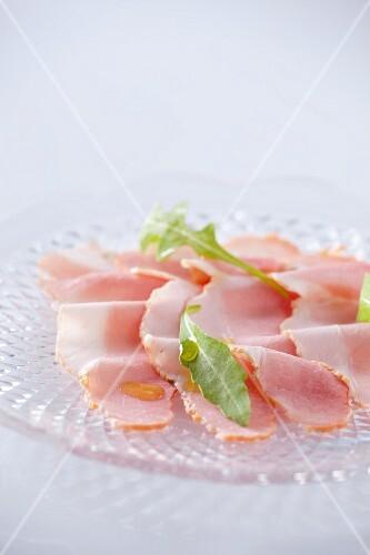 Sliced ham and rocket leaves