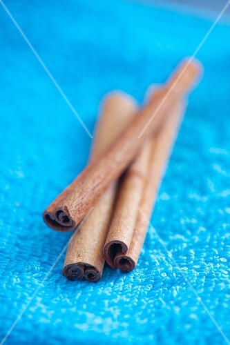 Cinnamon sticks on blue background