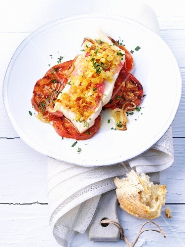 Pollock au gratin with onions and tomatoes