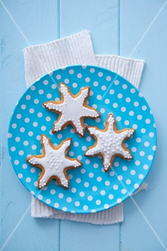 Three gingerbread stars garnished with icing