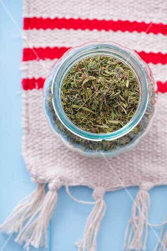 Jar of dried summer savory
