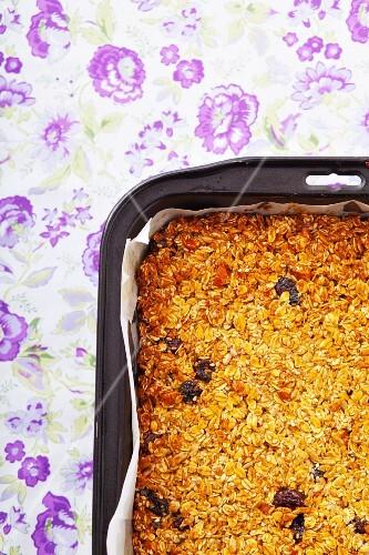 Muesli cake in a baking tin