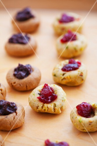 Unbaked chocolate and pistachio biscuits with jam
