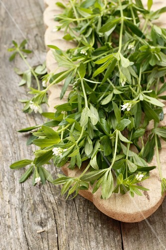 Fresh woodruff on a wooden serving platter