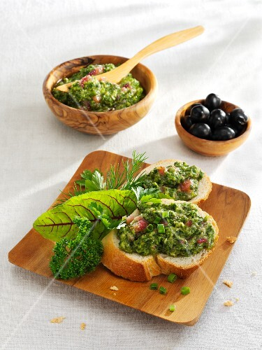 White bread with pesto made from the herbs used to make Grüne Sauce (green sauce)