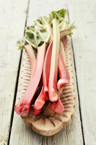 Rhubarb stalks on a wooden serving platter