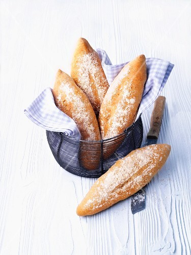 Amaranth bread rolls in a wire basket