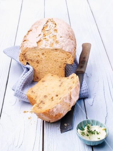 Potato bread, sliced open, on a tea towel