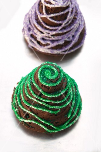 Colorfully decorated chocolate cakes with pumpkin and ginger