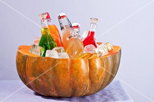 A hollowed out pumpkin as a bottle cooler