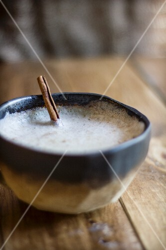 Chai Latte with Frothy Milk and a Cinnamon Stick
