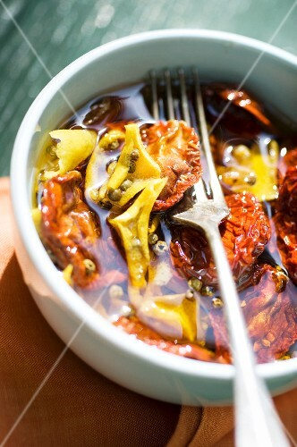 Preserved sundried tomatoes in a small bowl