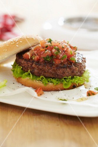 Grilled burger with tomato salsa