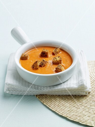 A Bowl of Roasted Red Pepper Soup with Garlic Croutons