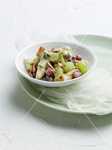 Grape and Apple Salad in a Yogurt Honey Dressing with Almonds in a Bowl