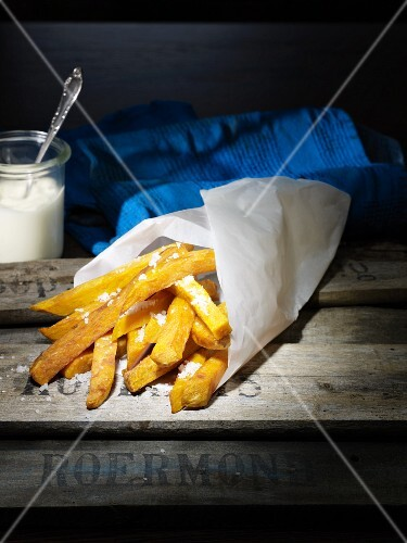 French fries made from red potatoes wrapped in paper