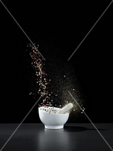 A splash of spices in a mortar