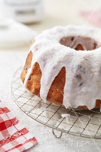 Bundt cake with rhubarb and coconut on a wire rack