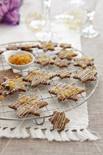 Chocolate orange star-shaped biscuits on a cooling rack