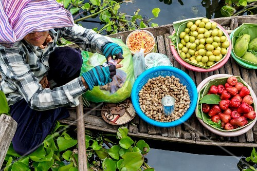 A floating market with peanuts and exotic fruits (Cambodia)