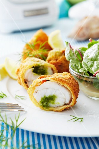 Breaded monk fish rolls with pesto filling