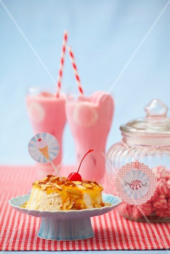 Semifreddo with almonds, honey and a glacé cherry, strawberry milkshakes and sweets