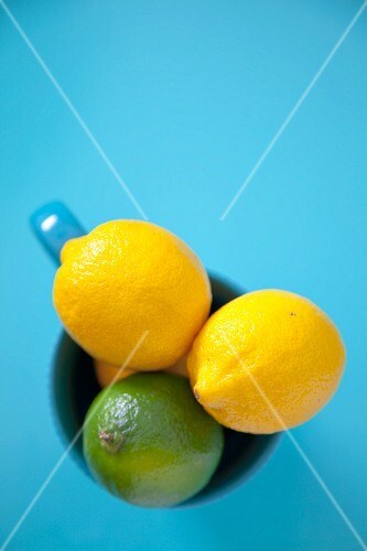 Lemons and a lime in a cup