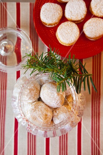 Butter biscuits in a storage jar and biscuits filled with lemon curd