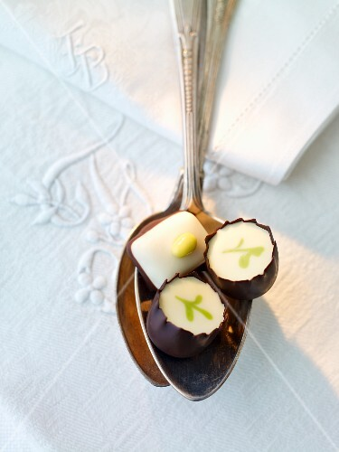 Three filled chocolates on a spoon